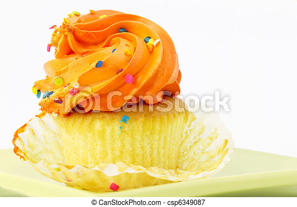 Cupcake with Orange Frosting and Paper Pulled Back - csp6349087