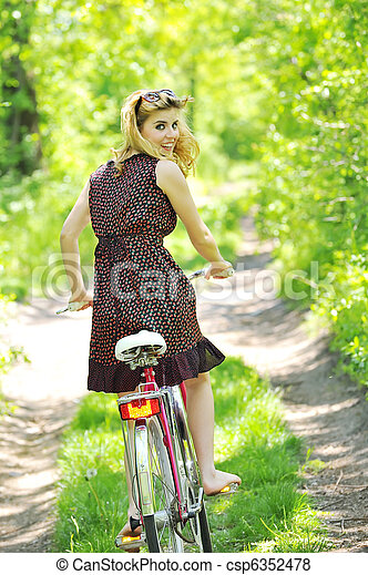 Young girl with a vintage bicycle - csp6352478