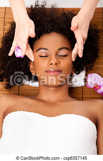 Facial temple massage in beauty spa - csp6357145
