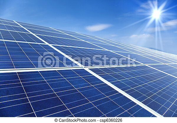 Closeup of Solar Panels with sunlight and blue sky background - csp6360226