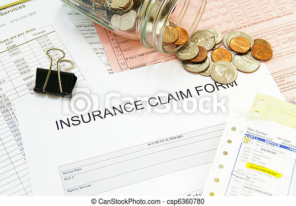 Assorted medical bills and a claim form with coins - csp6360780