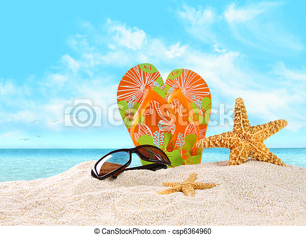 Flip- flops in the sand with starfish - csp6364960