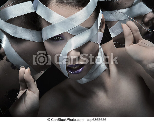 Reflections - film grain art photo of a beautiful young woman - csp6368686