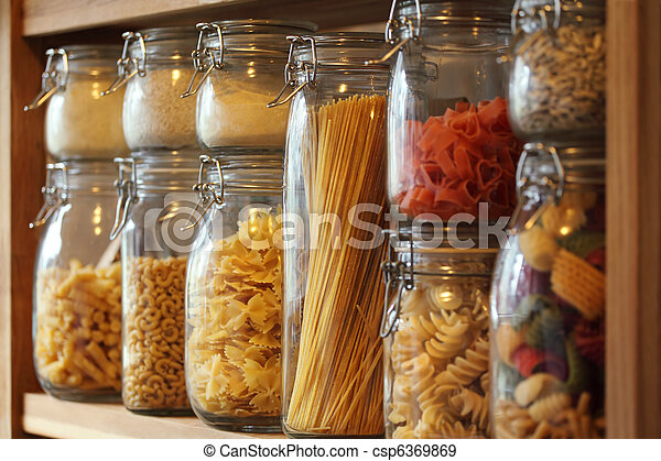 Dried pasta in jars on a shelf - csp6369869