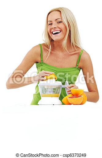 woman squeezes juice - csp6370249