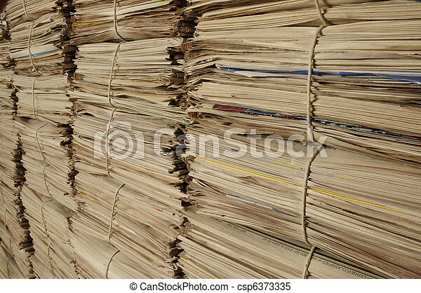 Piles of recycled newspapers on an angle - csp6373335