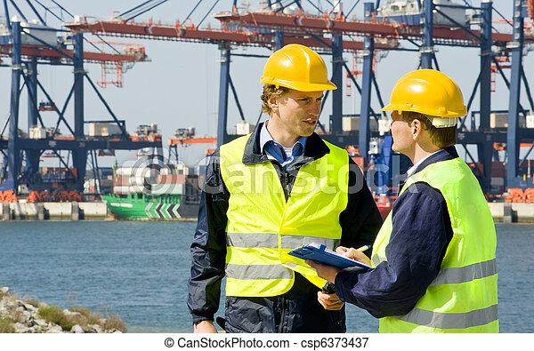 Dockers in a container harbor - csp6373437