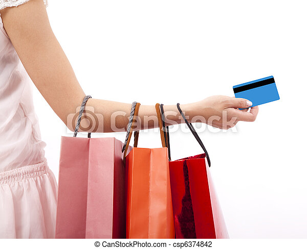 hand of woman holding shopping bags and credit card - csp6374842