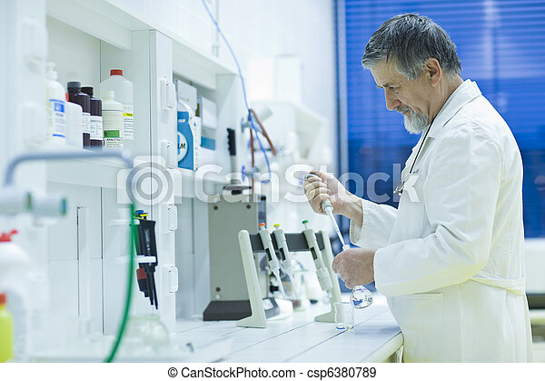 senior male researcher carrying out scientific research in a lab using a gas chromatograph (shallow DOF; color toned image) - csp6380789