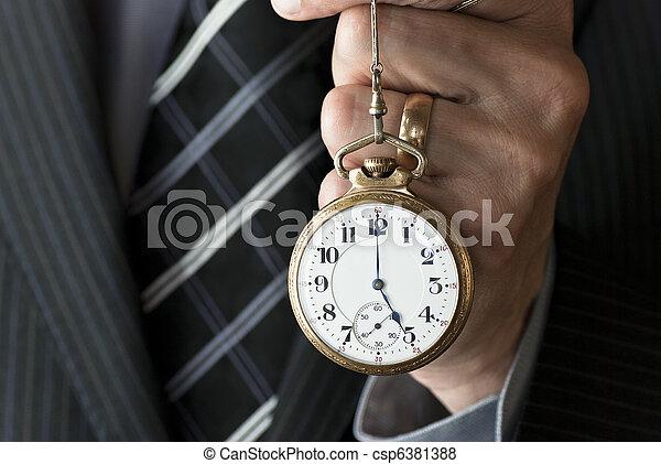 Businessman Holding Pocket Watch