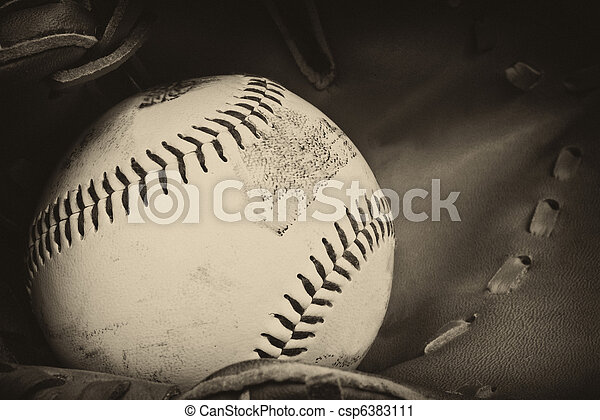 Vintage retro image of baseball and glove in old antique plate style of photograph - csp6383111