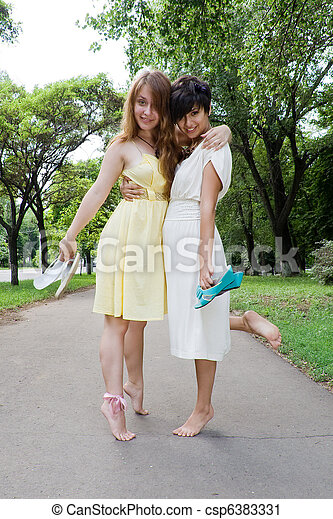 Young girls walking barefoot in the park - csp6383331