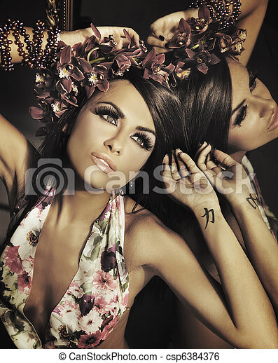 Young beautiful brunette posing at mirror - csp6384376