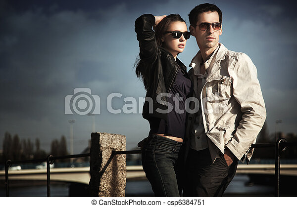 Attractive young couple wearing sunglasses - csp6384751