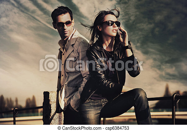Attractive young couple wearing sunglasses - csp6384753