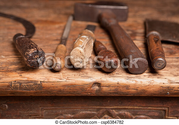 Bench with grungy tools - csp6384782