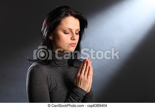 Religion moment eyes closed young woman in prayer - csp6389404