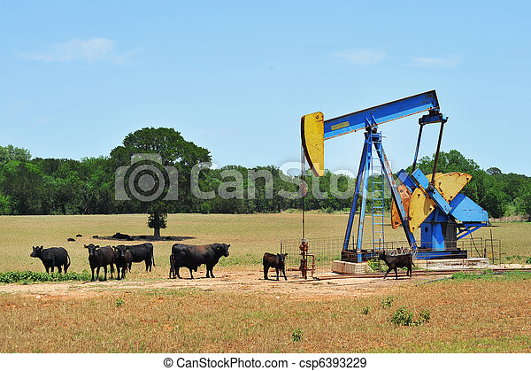 Oil Well Pumper and Cattle. - csp6393229