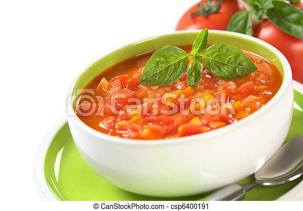 Chunky tomato soup made of tomatoes, carrots and onions and garnished with a basil leaf (Selective Focus, Focus on the basil leaf on the soup) - csp6400191