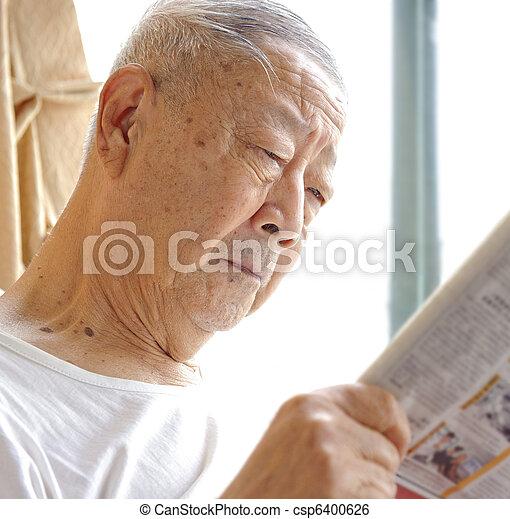 a senior man is reading - csp6400626