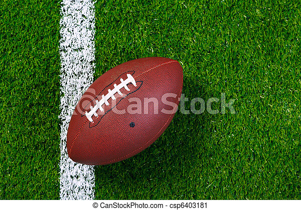 American football on grass from above. - csp6403181