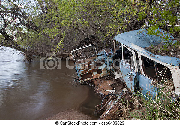 junk cars on river - csp6403623