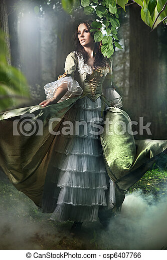 Gorgeous brunette beauty in a old-fashioned dress in a forest - csp6407766