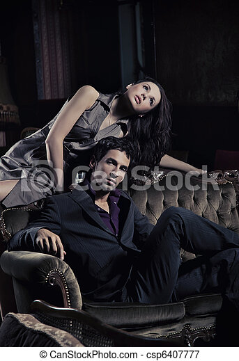 Gorgeous young couple in a stylish interior - csp6407777