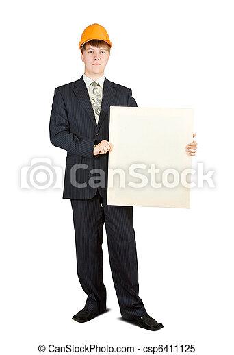 businessman in hardhat holding banner - csp6411125