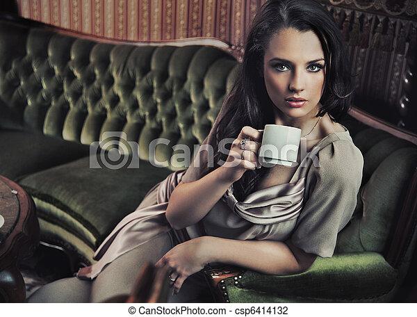 Stylish woman drinking coffee - csp6414132