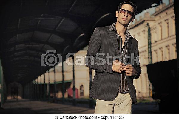 Fashion style photo of an handsome elegant man - csp6414135