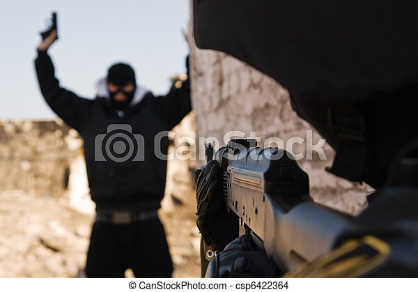 Soldier arresting armed criminal - csp6422364