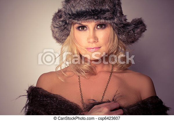 Fashion Wearing woman in fur Hat And Coat - csp6423607