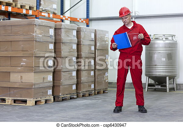 Worker in a company warehouse - csp6430947