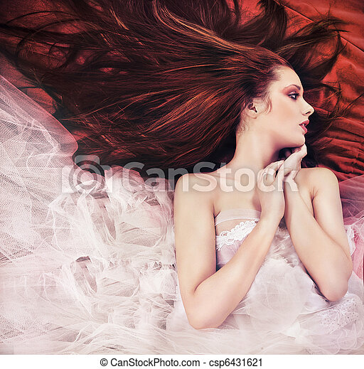 Ginger long haired young woman in sensual pose - csp6431621