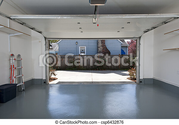 Stock image of clean garage interior of a clean garage for Largeur porte garage double