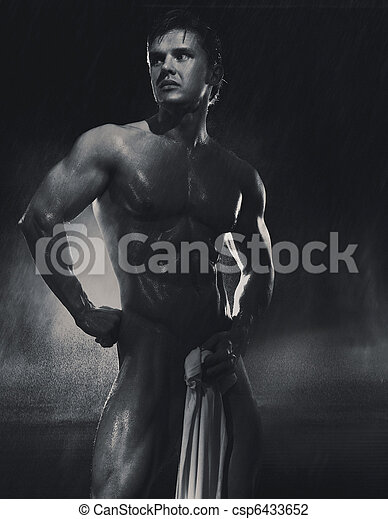 Young handsome athlete standing in the rain - csp6433652
