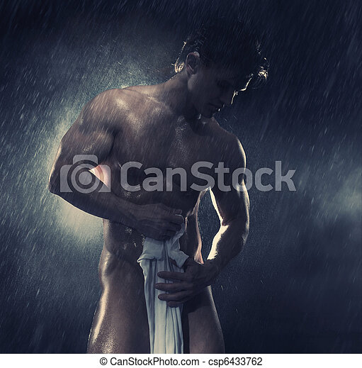 Young handsome athlete standing in the rain - csp6433762