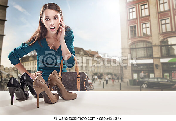 Young woman looking at the shop window - csp6433877