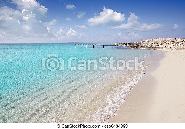 Formentera beach wood pier turquoise balearic sea - csp6434393