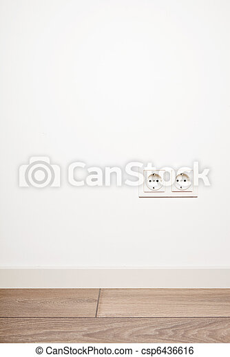 Double electricity power socket (european standard) on blank white wall background over moder wooden floor - csp6436616