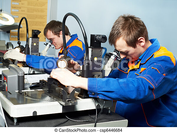 two workers at tool workshop - csp6446684