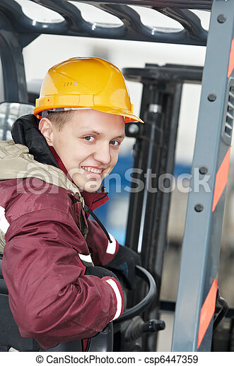 warehouse worker driver in  forklift - csp6447359