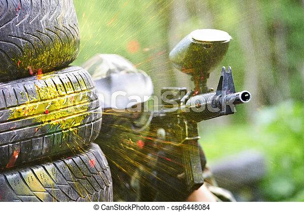 paintball player under gunfire - csp6448084