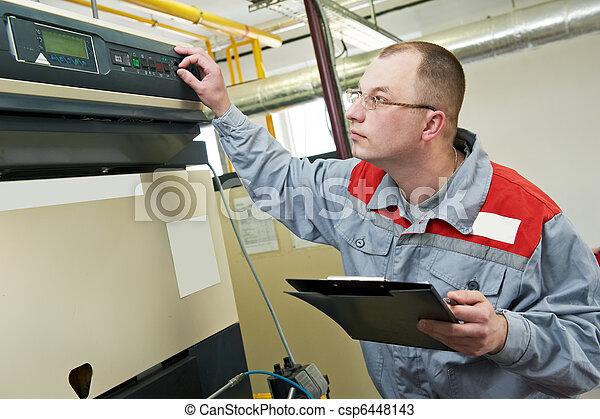 heating engineer in boiler room - csp6448143