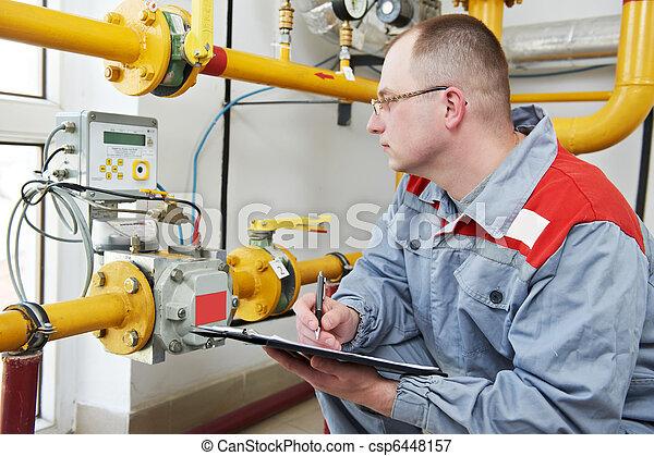 heating engineer in boiler room - csp6448157