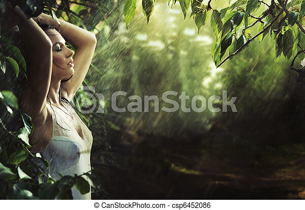 Adorable sexy brunette in a rain forest - csp6452086