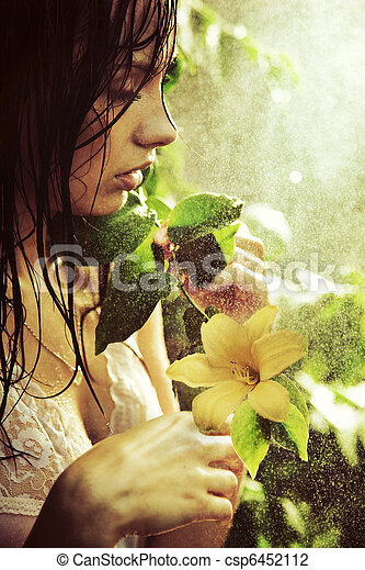 Young stunning beauty with flower - csp6452112