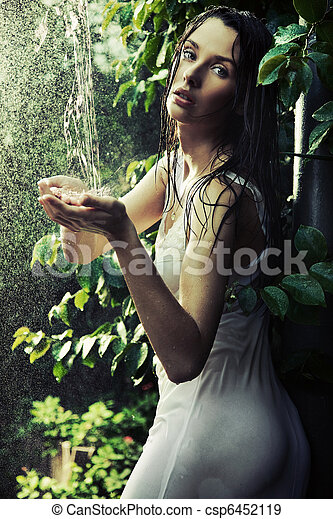 Young woman in a rain forest - csp6452119