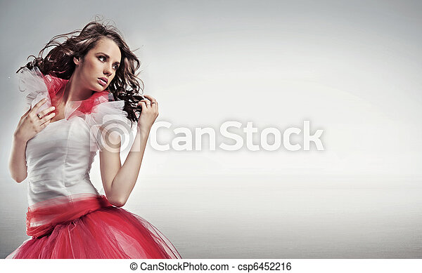Pretty brunette posing, lots of copy space - csp6452216
